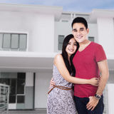 Couple In Front Of New Home Royalty Free Stock Photo