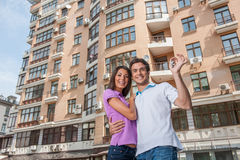 Couple in front of new home holding door keys Royalty Free Stock Photo