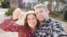 Couple In Front of New Home Showing Off Their House Keys