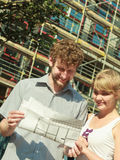 Couple on front of new house with blueprint project Royalty Free Stock Photo
