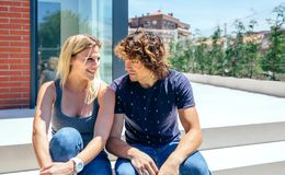 Couple in front new house. Smiling couple in front of their new house royalty free stock photo