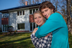 Couple in front of the new house. Young couple in front of the new big house stock photos