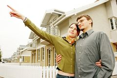 Couple in front of one-family house stock photos