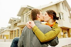 Couple in front of one-family house Royalty Free Stock Photo