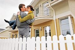 Couple in front of one-family house royalty free stock image