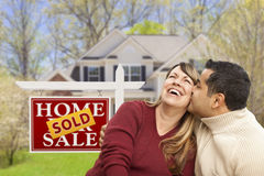 Couple in Front of Sold Real Estate Sign and House Stock Photography