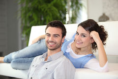 Couple in front of television Stock Images