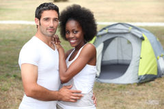 Couple in front of tent Stock Photo