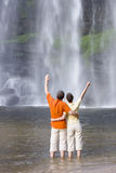 Couple in front of a tropical waterfall Stock Image