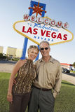 Couple In Front Of Welcome To Las Vegas Sign Royalty Free Stock Photography