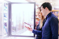 Couple in the frozen goods section Royalty Free Stock Image
