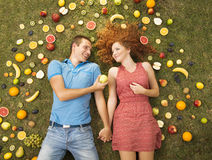 Couple with fruit Stock Image