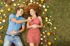 Couple with fruit Royalty Free Stock Photography