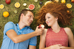 Couple with fruit Royalty Free Stock Photo