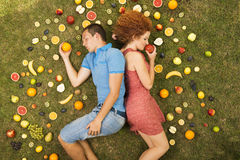 Couple with fruit Royalty Free Stock Image
