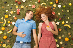 Couple with fruit Stock Photography