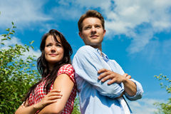 Couple in fruit orchard after summer Stock Images