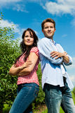 Couple in fruit orchard after summer Royalty Free Stock Image