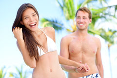 Couple fun at beach holding hands Stock Image