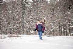 Couple fun in snow Stock Photos