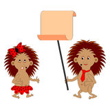 A couple of funny cartoon hedgehogs with a big blank paper Royalty Free Stock Images