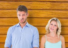 couple  funny faces with yellow wood background Stock Photo