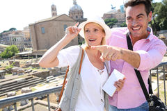 Couple with a funny look standing in Roman Forum Royalty Free Stock Image