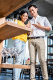 Couple in furniture store choosing glasses Stock Images