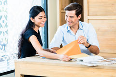 Couple in furniture store choosing material Stock Image