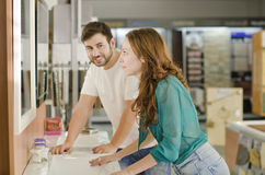 Couple in furniture store looking sink and mirror Stock Photos
