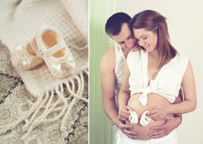 Couple future parents posing with knitted baby booties. Stock Photos
