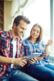 Couple with gadgets Stock Photos