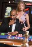 Couple gambling at roulette table. In casino Stock Image