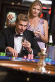 Couple gambling at roulettte table. Couple gambling at roulette table in casino Royalty Free Stock Image