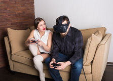 Couple of gamers at home. With VR headset Royalty Free Stock Photos