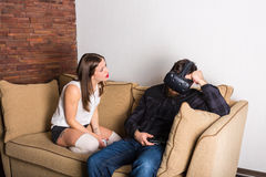 Couple of gamers at home. With VR headset Stock Photos