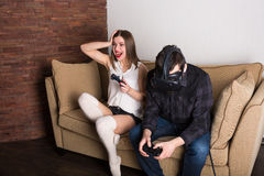 Couple of gamers at home. With VR headset Royalty Free Stock Photo