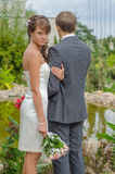The couple in the garden. bride looks in the picture Royalty Free Stock Photos