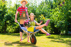 Couple in garden with watering can Stock Image