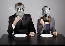 Couple at gas masks Stock Image