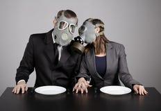 Couple at gas masks Royalty Free Stock Photo