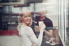 Couple At Gas Station Cafe. Using Taking A Rest Royalty Free Stock Photos