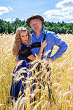 Couple in german tracht on the field Stock Images