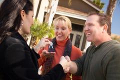 Couple Get House Keys From Hispanic Agent Royalty Free Stock Photo