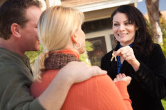 Couple Get House Keys from Hispanic Agent Stock Photography