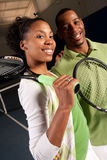 A couple gets ready to play tennis Stock Photos