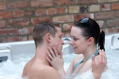 A couple getting close in a jacuzzi Stock Photography