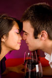Couple Getting Closer While Having Wine Stock Photo