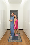 Couple getting dressed in pijamas Stock Image