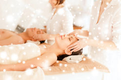 Couple getting facial massage in spa Stock Photos